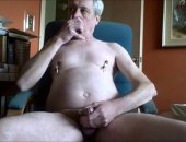 mature man uses nipple clamps
