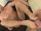 Guy gives footjob to a fat hard cock
