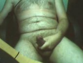 hairy dude slides his hand down his shlong