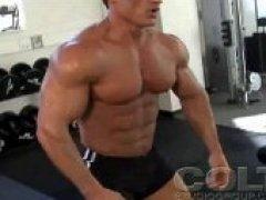 Muscular Guy Flexes Off