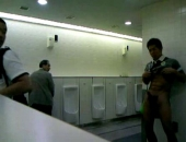 Asian boy takes a piss in the public bathroom then does the unthinkable jerking off in the middle of the room.